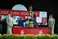Bill Casner (WinStar Farm) hoists the Dubai World Cup as presented by Sheikh Mohammed bin Rashid Al Maktoum, Vice-President of the UAE and Ruler of Dubai