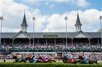 The field passes the Twin Spires the first time in the Churchill Downs Distaff Turf Mile on Kentucky Derby Day at Churchill Downs in Louisville, Kentucky on May 5, 2012.