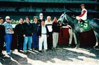 Rene Araya, pictured center front, in the winner's circle with Paul Pompa, Jr.-owned Judge's Case on May 1, 2002 at Aqueduct Racetrack. Photo credit: NYRA Photo.