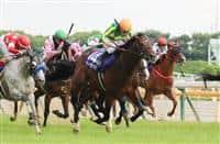 Satono Aladdin wins the Group 1 Yasuda Kinen under jockey Yuga Kawada