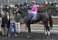 Charitable Man in the winner's circle for the Peter Pan